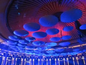 Acoustic diffusing discs (lit in blue) hanging from the roof of the Hall Courtesy: Wikipedia